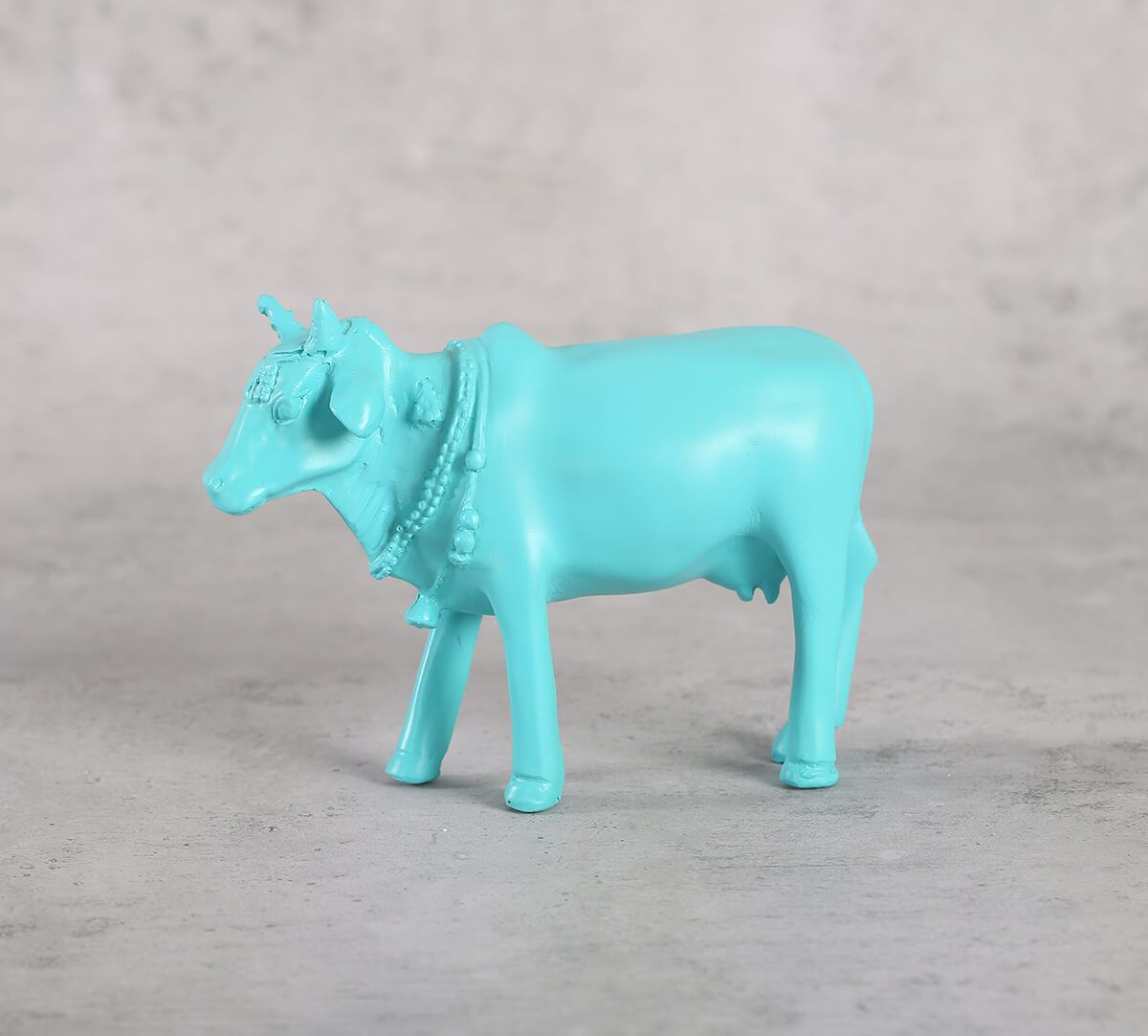 India Circus Cerulean Cow Figurine